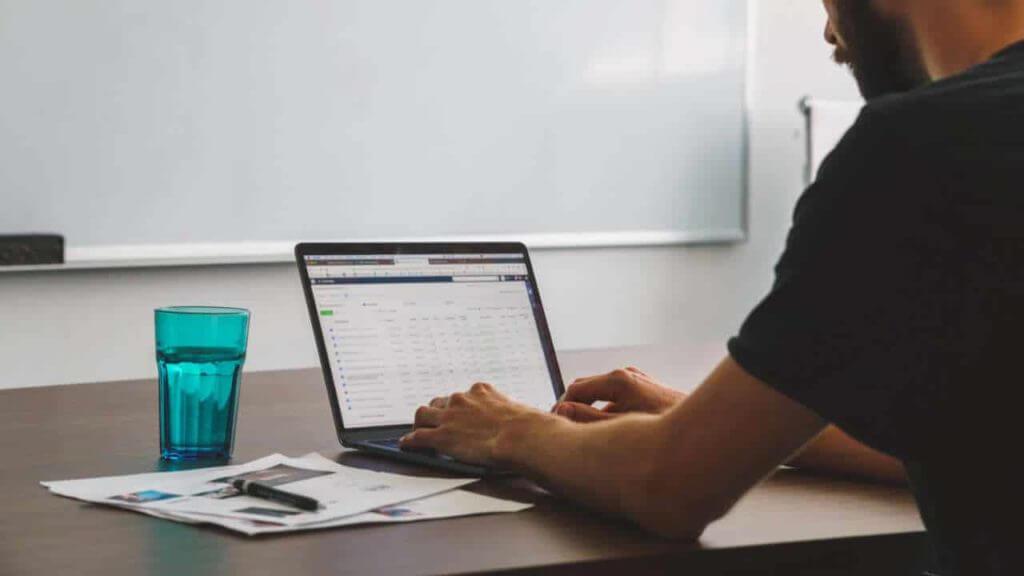 man-working-on-spreadsheet